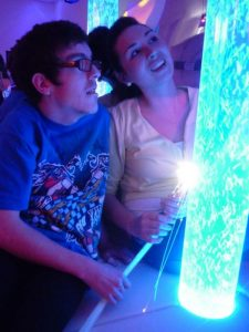 Hannah Oliver introduces resident Ben Corran Williams to the new sensory room