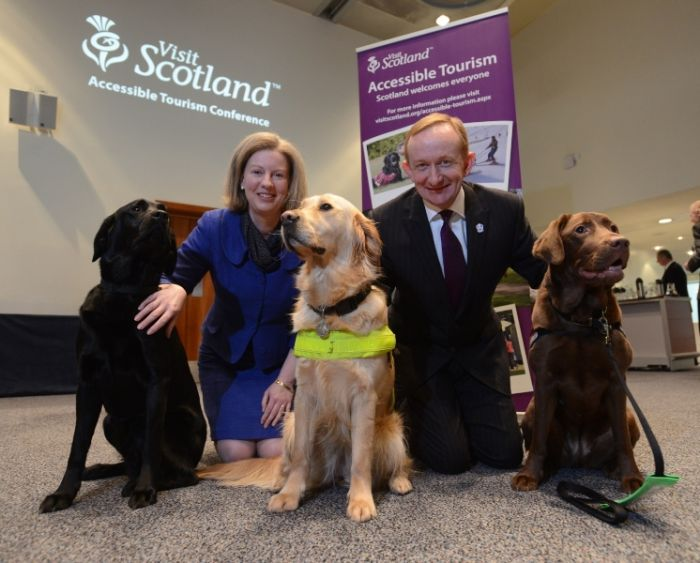 Shona Robison, Minister for Commonwealth Games and Sport and Mike Cantlay, Chairman of VisitScotland today met with Robyn (brown Labrador: hearing dog), Winter (black Labrador: guide dog) and Gigi (Golden Retriever: guide dog) as part of Scotland's first Accessibility Conference.