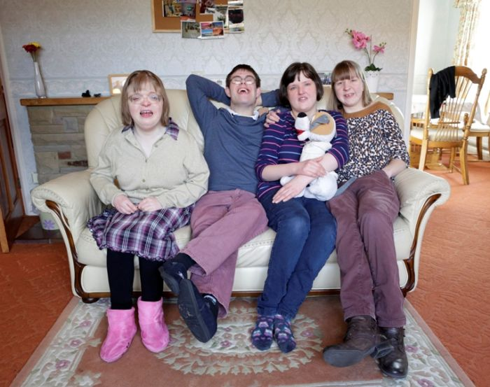 Claire Donaldson, James Wilkinson, Lizzie Searle and Sarah Gibson, who have just moved into a brand new house in Easingwold, North Yorkshrie, thanks to investors in the bond.  © Golden Lane Housing (Credit: Layton Thompson)