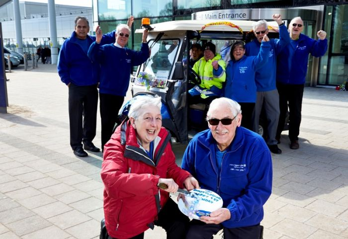 Picture by Edward Moss www.edwardmoss.co.uk All rights reserved.  NEWS@QE QE Hospital One year anniversary of the Buggy Shuttle (L-R) Jackie Henderson and Hubert Powell pictured with drivers and volunteers