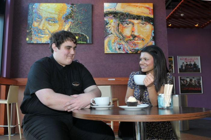 Chris Birss (left) enjoying a coffee at the Light Cinema in New Brighton where he is employed, with the Wirral Autistic Society's Step into Work placement officer Hema Chandrashekhar