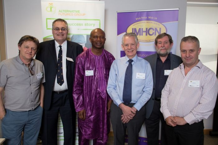 (L - R): Paul Baker, IMHCN Secretary; Terry Davies, Consultant, West Wales Action for Mental Health; Salifu Manneh, Director of Mobee Gambia; Neil Campbell, AFG Chief Executive; John Jenkins, IMHCN Chair and Mike Smith, AFG Clinical Director
