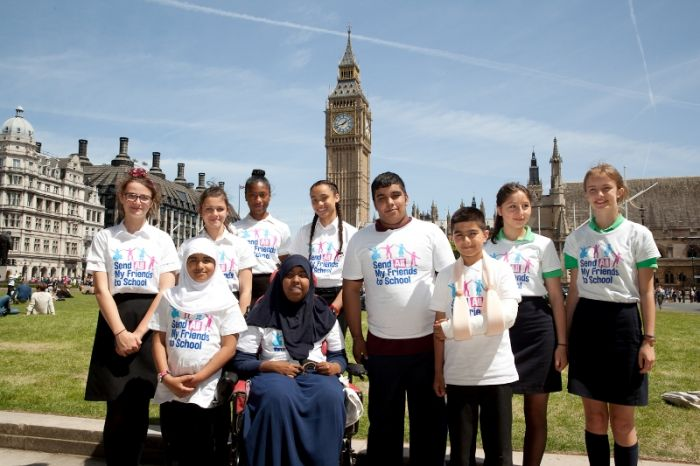The young campaigners outside the Houses of Parliament (PHOTO: Georgie Scott)