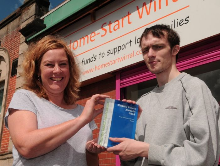 Step into Work Plus student Ralph Smith celebrates winning his Charity Retail Association Young Volunteer of the Year award with Home Start Wirral store manager Sara Forfar