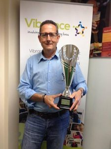 Paul Allen Holds The Vibrance 25th Anniversary Celebration Trophy