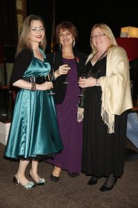 vonne Crowhurst from Wirral Autistic Society (centre) celebrates winning the title of Best Care Trainer at the North West heats of the Great British Care Awards. Pictured here with (from left) colleagues Yvonne Smith and Jane Carolan
