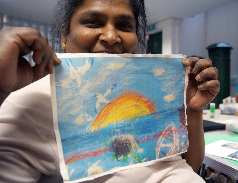 Raji with her artwork