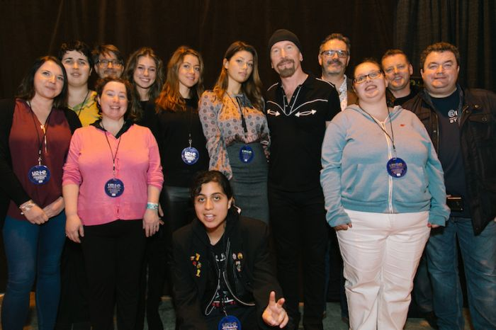 Ticket winners and Young Ambassadors with a learning disability meet U2's The Edge.