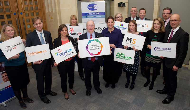 Alistair Burt MP, Minister of State for Care and Support (centre), with the Carers Week charity partners, sponsors and supporting organisations.
