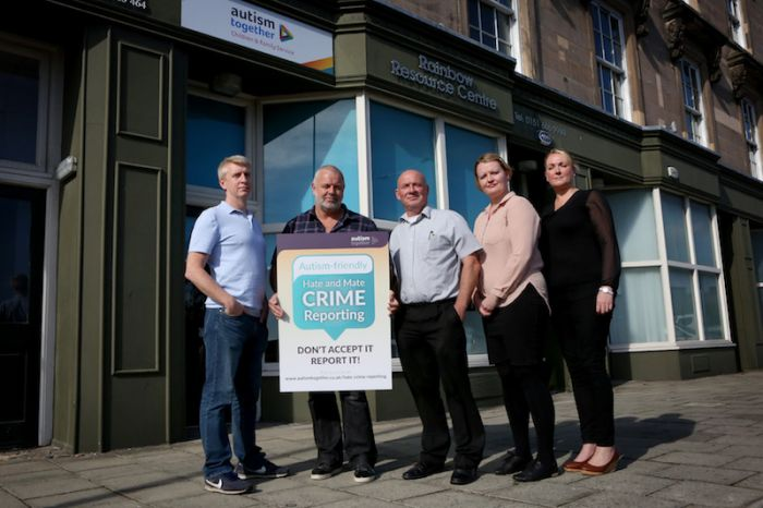 (From left) Steve Collins, Steve Vasey, Terry Usher, Ruth Edwards and Laura Edwards, all from Merseyside charity Autism Together, will be helping people with autism report disability hate and mate crimes at three newly opened reporting centres.