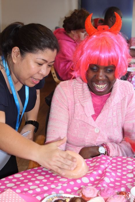YARROW Macmillan nurse Bernadel Rizon and Labake Anisere at Yarrow Charity Breast Awareness Tea Party for women with learning difficulties copy